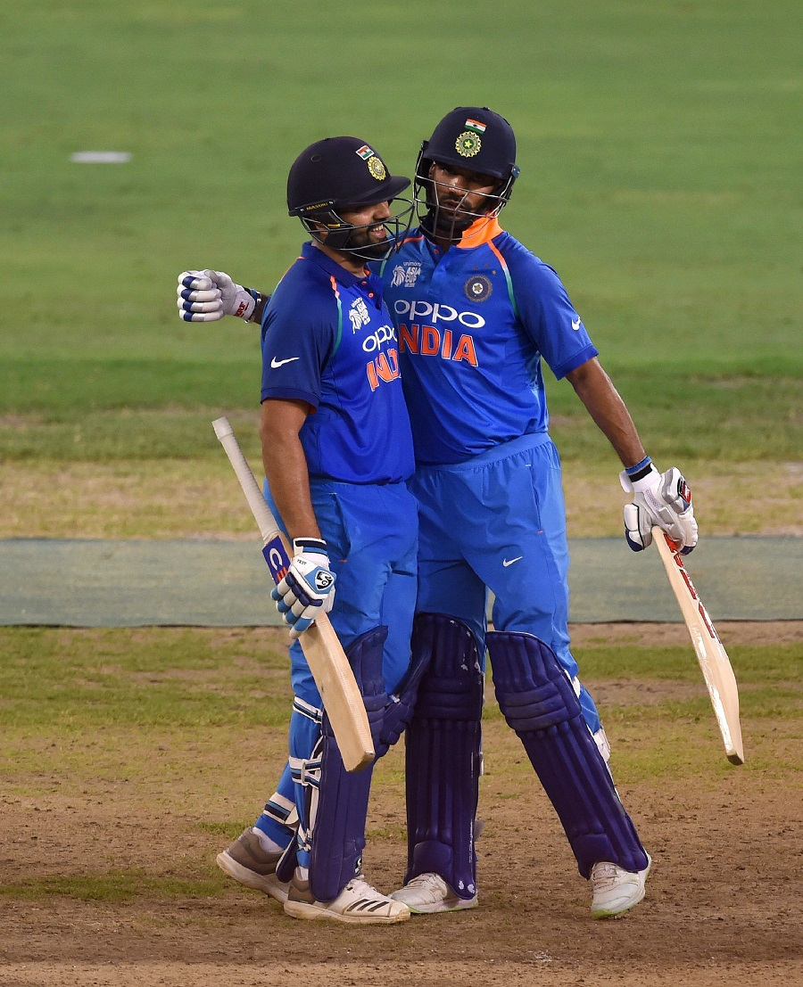 Indian cricket team captain Rohit Sharma (L) and teammate Shikhar Dhawan greet each other during the ODI. PHOTO: AFP