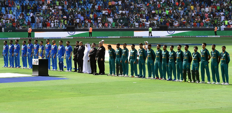 Pakistan and Indian players line up for the national anthem just before the start of the ODI. PHOTO: AFP