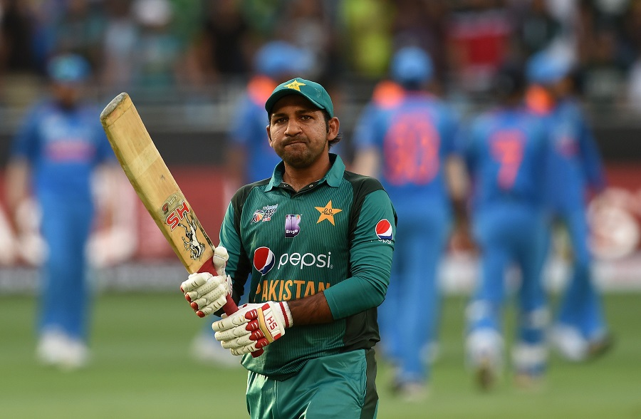 Sarfraz Ahmed leaves the field after being dismissed. PHOTO: AFP