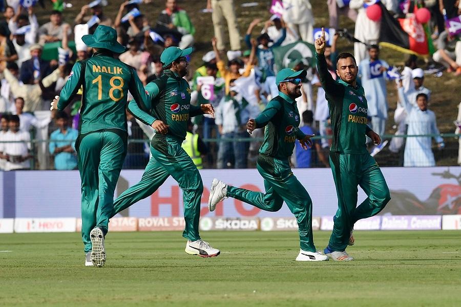 Mohammad Nawaz (R) celebrates after he dismissed Afghan batsman Mohammad Shahzad. PHOTO: AFP