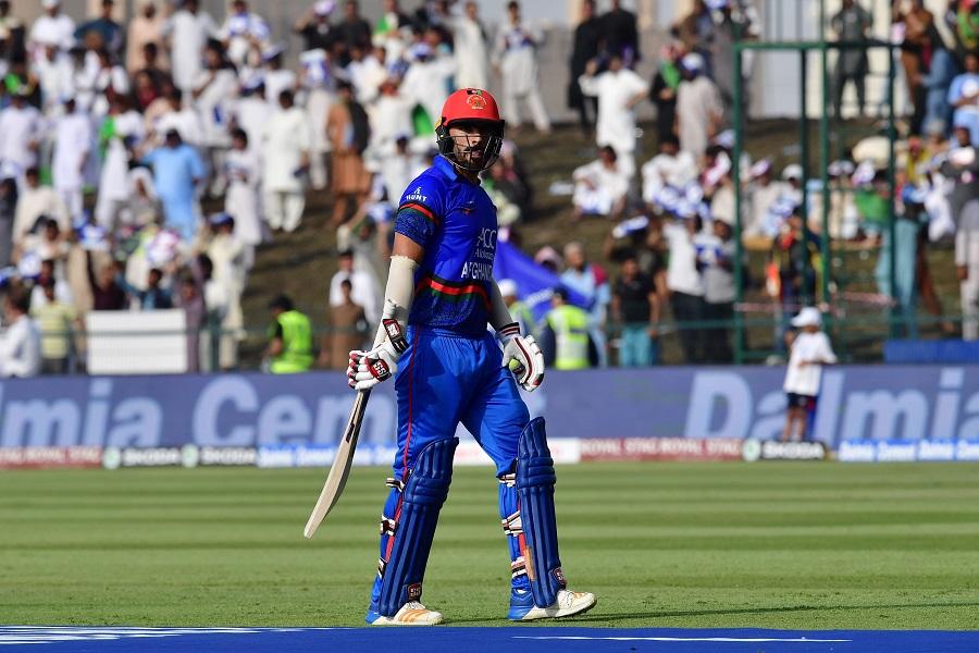Afghan batsman Ihsanullah Janat leaves the pitch after being dismissed. PHOTO: AFP