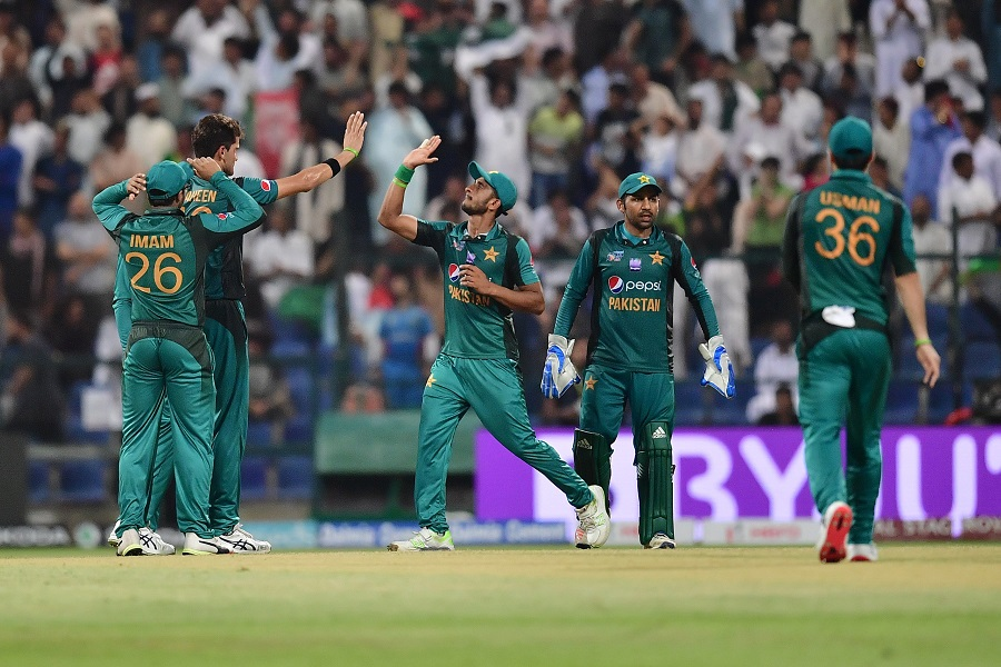 Pakistan's cricketers celebrate after Afghanistan team captain and batsman Mohammad Asghar is dismissed. PHOTO: AFP