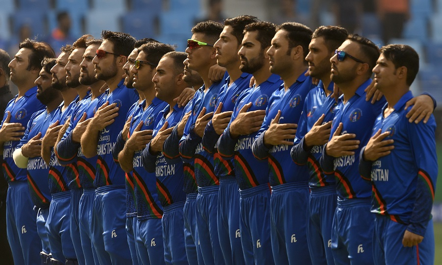 Afghanistan players line up for the national anthems before start of play. PHOTO: AFP