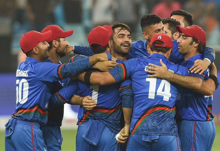 Afghan cricketer Rashid Khan (C), captain Asghar Afghan (R) celebrates with teammate after Match tied. PHOTO: AFP