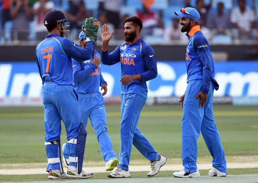 Indian cricketer Ravindra Jadeja (2R) celebrates with teammates after he dismissed Afghan batsman Rahmat Shah. PHOTO: AFP