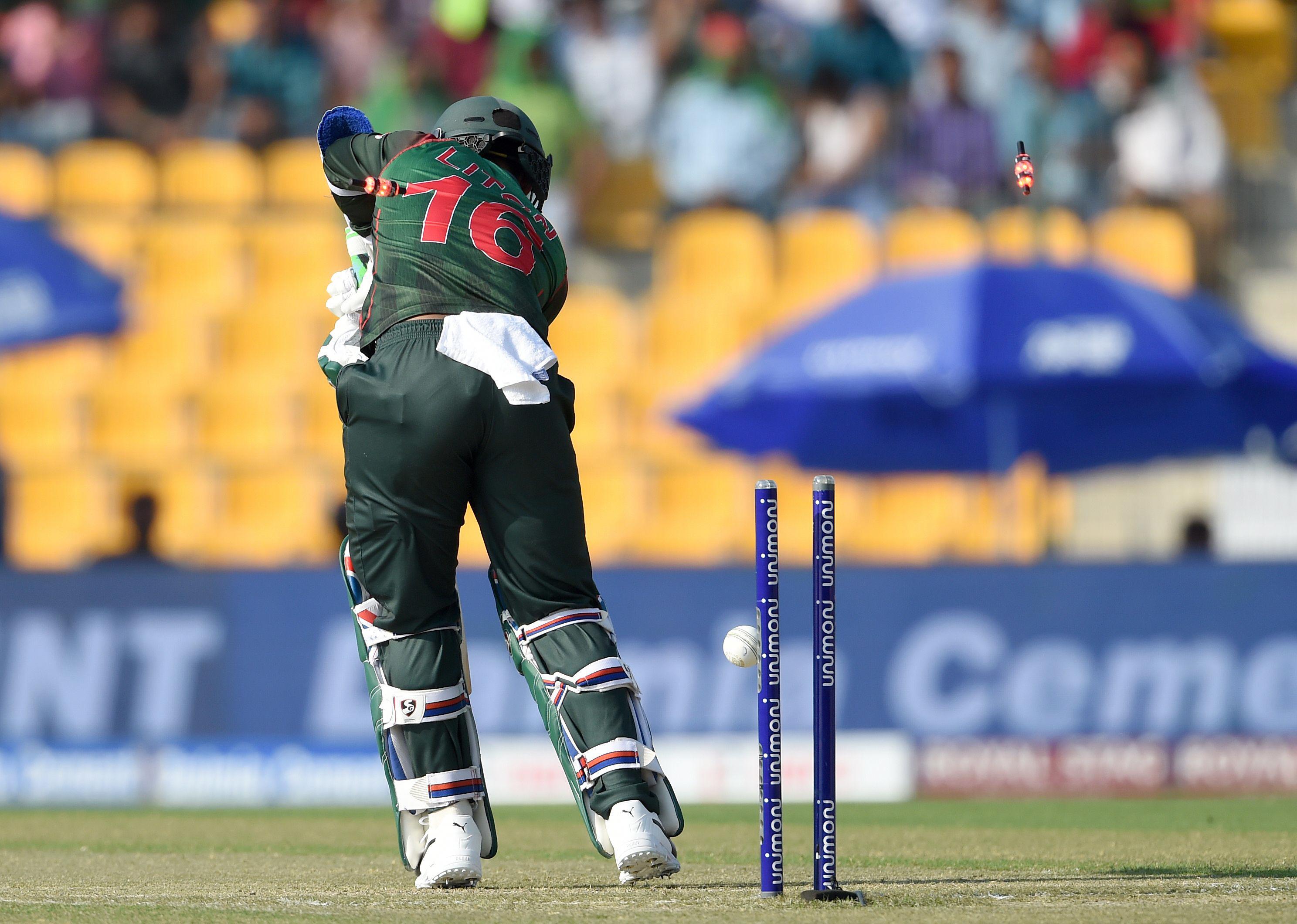 Bangladesh batsman Liton Das is dismissed by Pakistan cricketer Junaid Khan