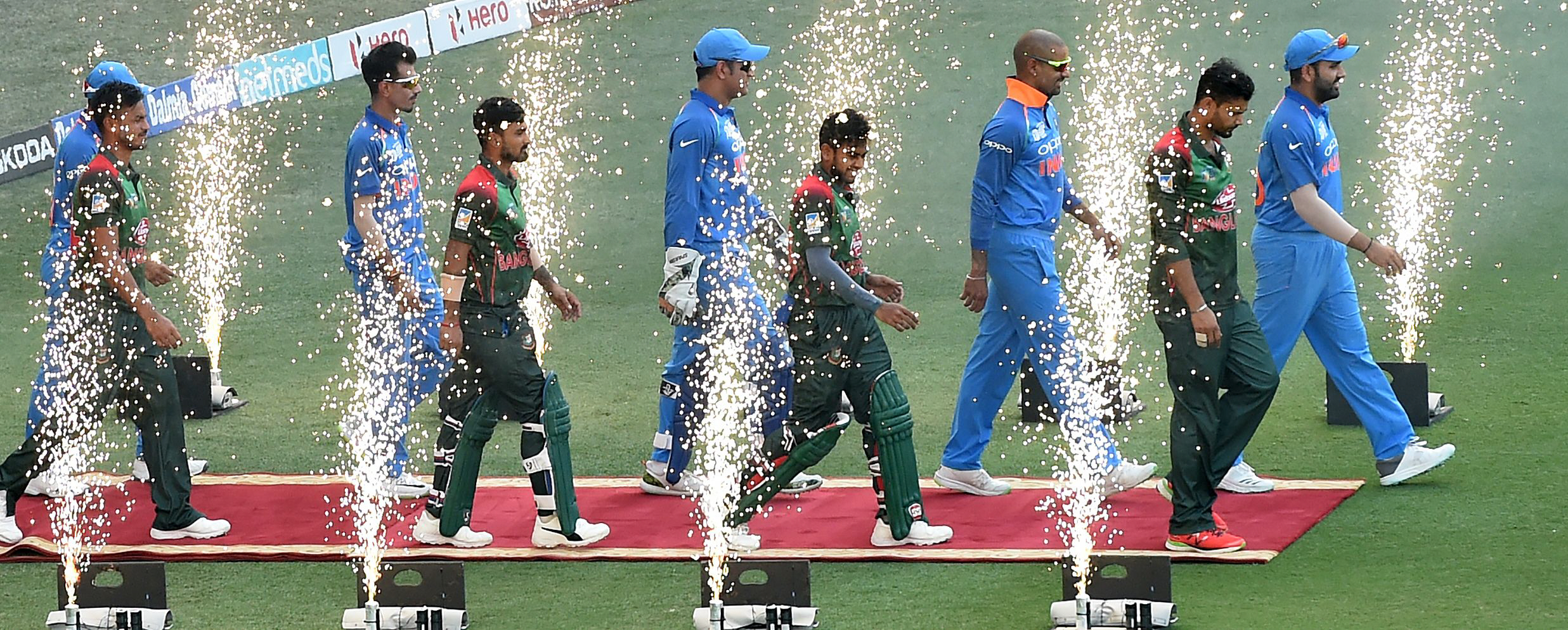 Indian cricket team captain Rohit Sharma (R), Bangladesh cricket captain Mashrafe Mortaza (2R) and teammates arrival during the final one day international (ODI) Asia Cup cricket match between Bangladesh and India at the Dubai International Cricket Stadiu