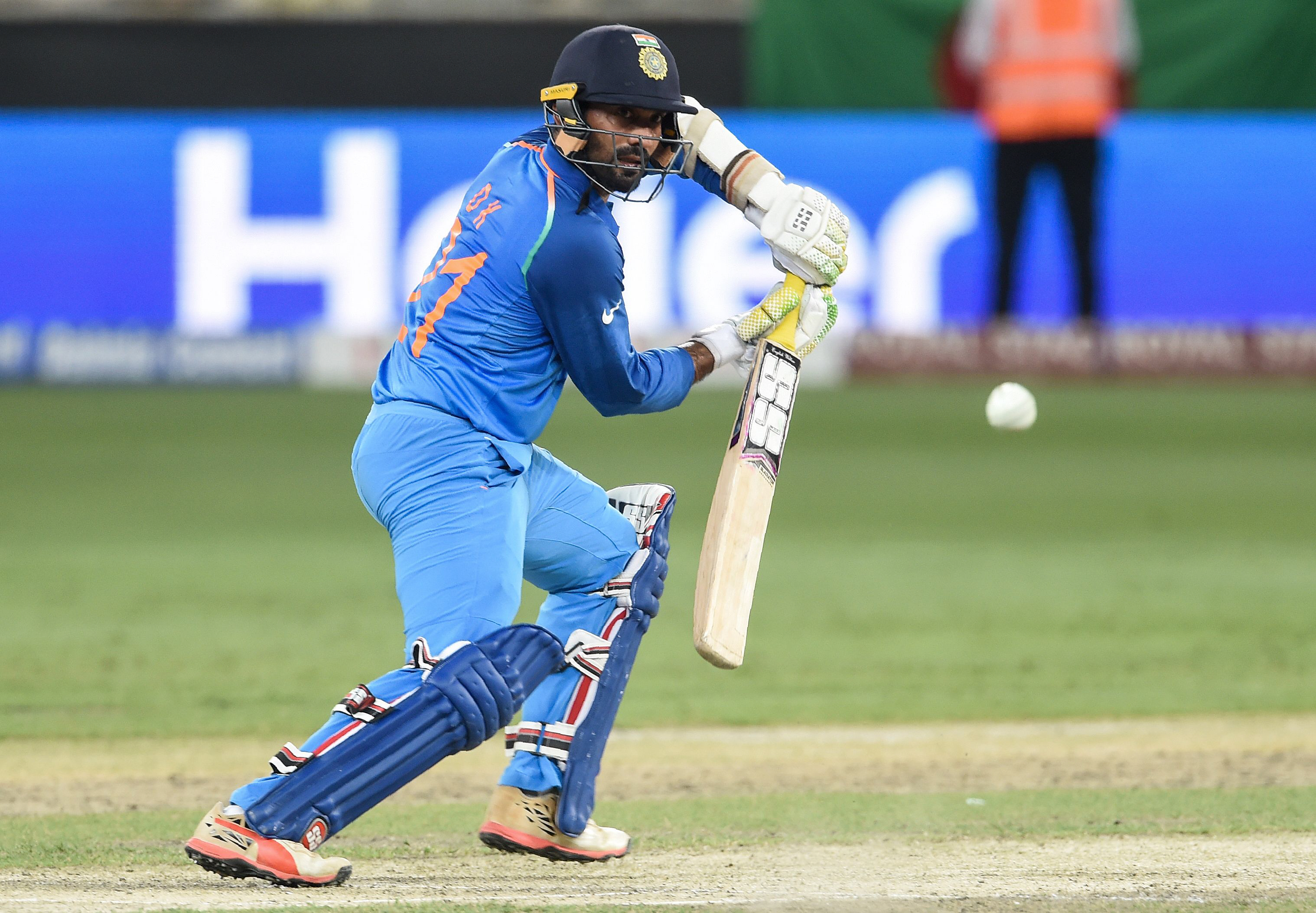 Indian batsman Dinesh Karthik plays a shot during the final one day international (ODI) Asia Cup cricket match between Bangladesh and India at the Dubai International Cricket Stadium in Dubai