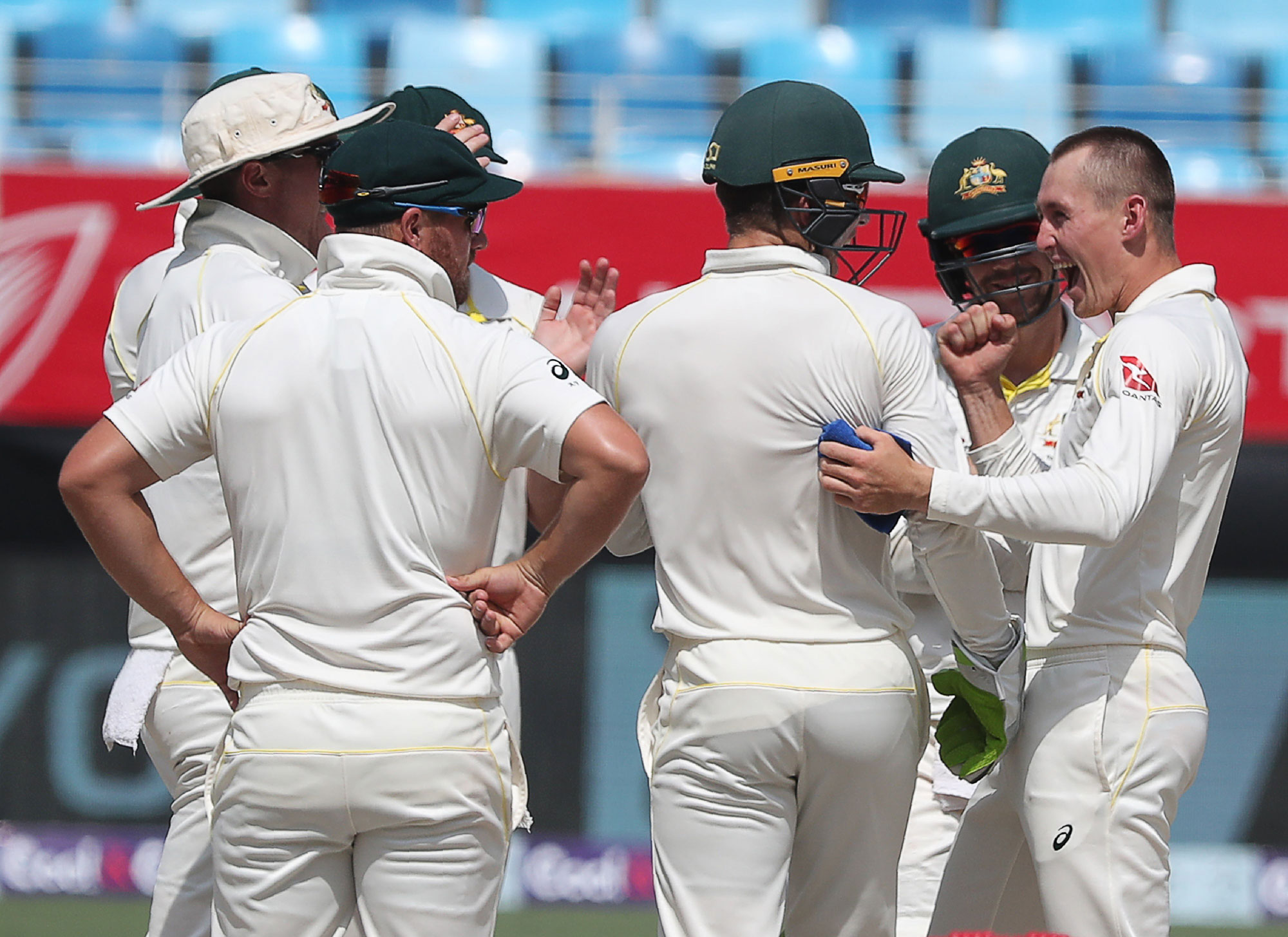 1.	Australian cricketer Marnus Labuschagne (R) celebrates after taking the wicket of Pakistan  cricketer Haris Sohail during day four of the first Test cricket match in the series between Australia and Pakistan at the Dubai International Stadium in Dubai