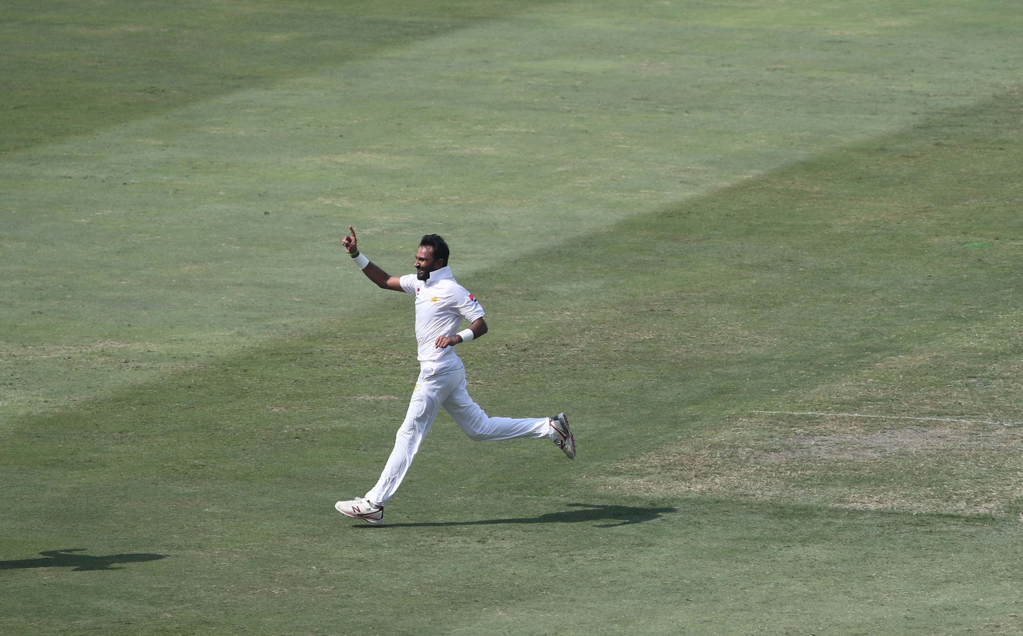 1.	Pakistan cricketer Bilal Asif celebrates after taking the wicket of  Australian batsman Usman Khawaja during the third day of play of the first Test cricket match in the series between Australia and Pakistan at the Dubai International Stadium in Dubai