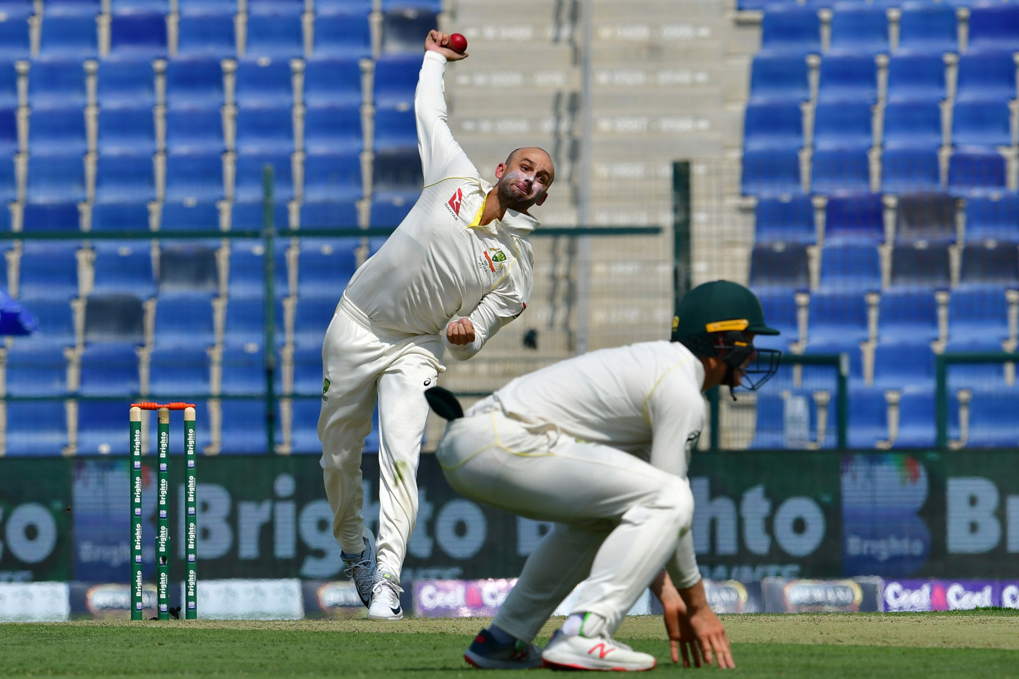 Australia cricketer Nathan Lyon bowls during day one of the second Test cricket match in the series between Australia and Pakistan at the Abu Dhabi Cricket Stadium in Abu Dhabi on October 16, 2018. (Photo by GIUSEPPE CACACE / AFP)
