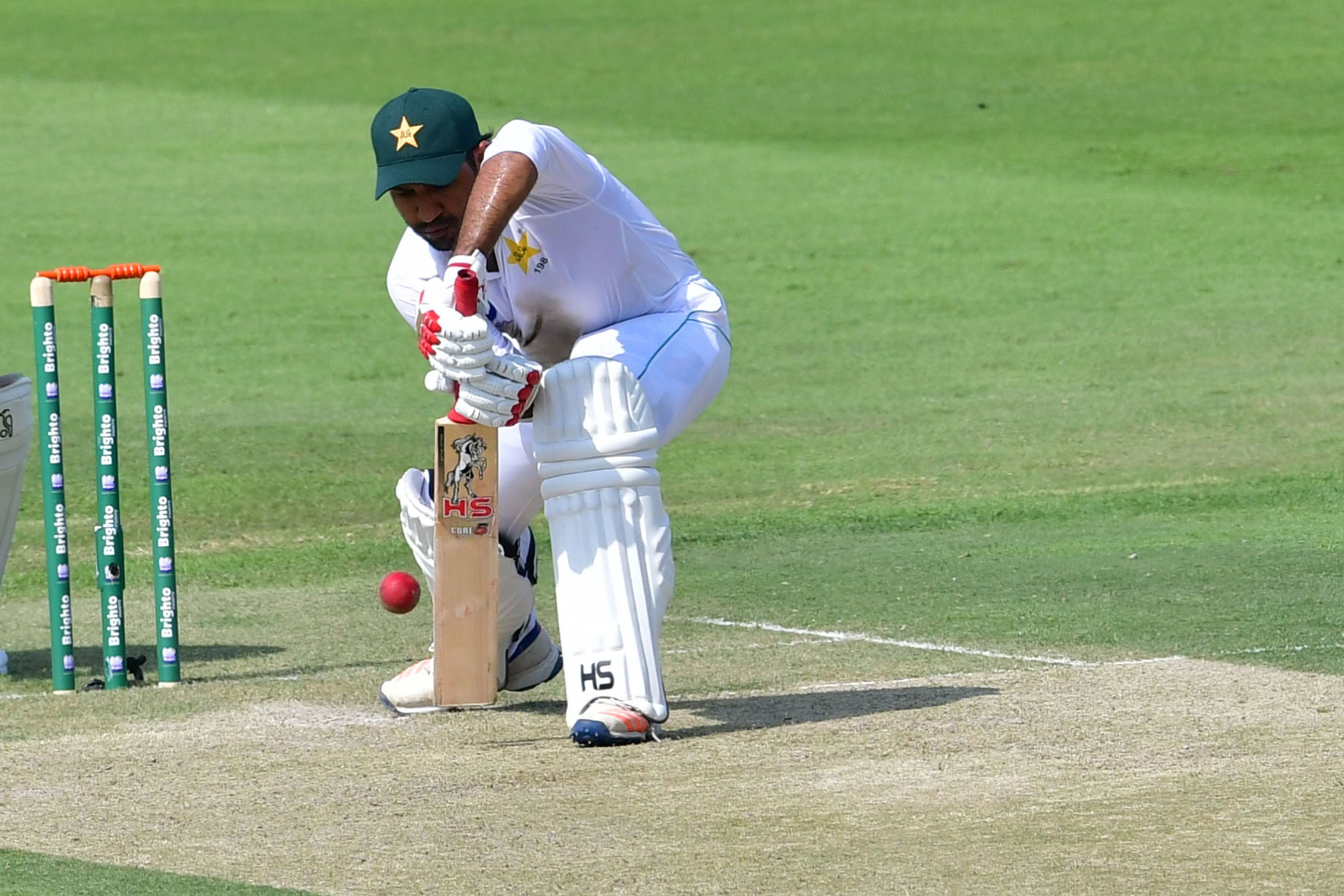 Pakistani cricketer Ahmed Sarfraz plays a shot during day one of the second Test cricket match in the series between Australia and Pakistan at the Abu Dhabi Cricket Stadium in Abu Dhabi on October 16, 2018. (Photo by GIUSEPPE CACACE / AFP)