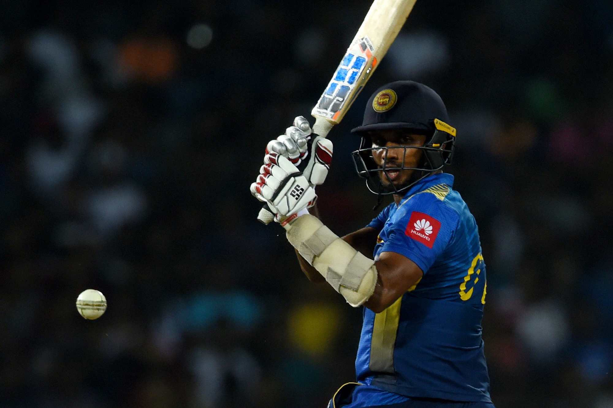 Sri Lankan cricketer Dasun Shanaka is dismissed by England's bowler Liam Plunkett (not pictured) during the International Twenty20 cricket match between Sri Lanka and England at the R Peremadasa Stadium in Colombo on October 27, 2018. (Photo by ISHARA S.