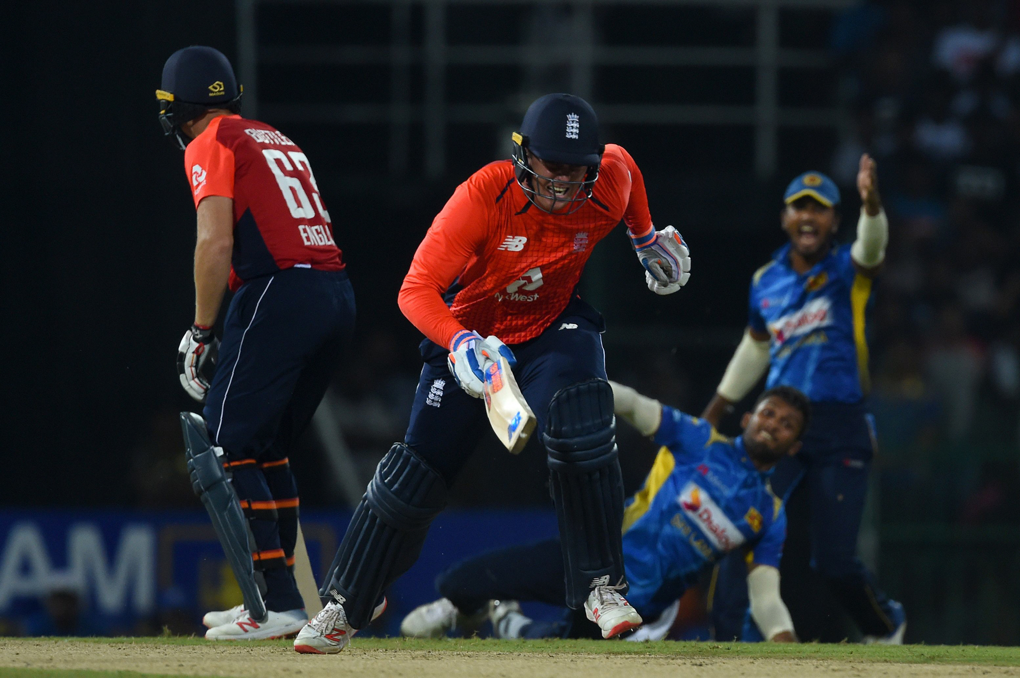 England cricketer Jason Roy (2L) runs between the wickets during the international Twenty20 cricket match between Sri Lanka and England at the R. Peremadasa Stadium in Colombo on October 27, 2018. (Photo by ISHARA S. KODIKARA / AFP)