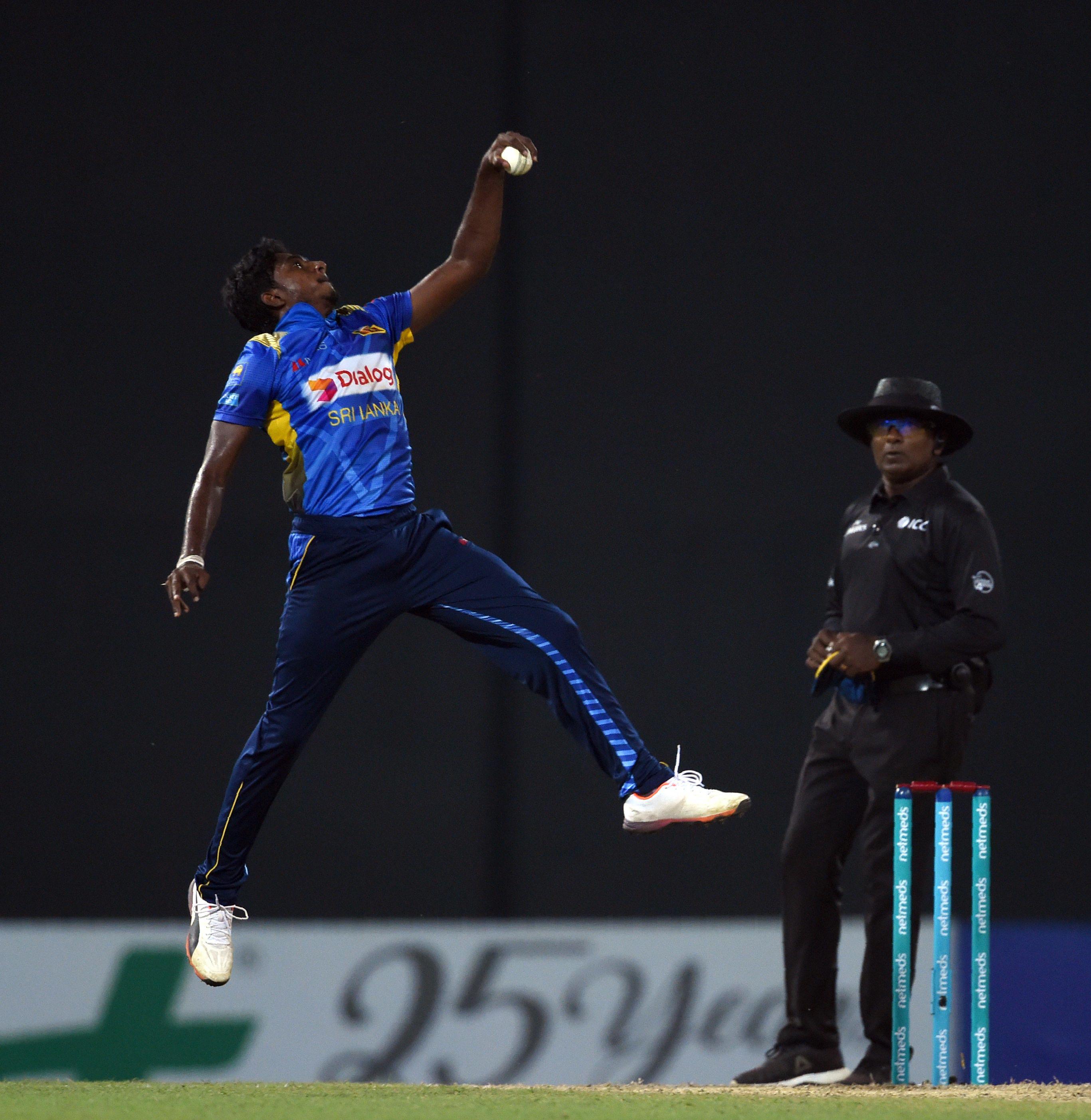 Sri Lankan cricketer Lakshan Sandakan stop ball during the international Twenty20 cricket match between Sri Lanka and England at the R. Peremadasa Stadium in Colombo on October 27, 2018. (Photo by ISHARA S. KODIKARA / AFP)