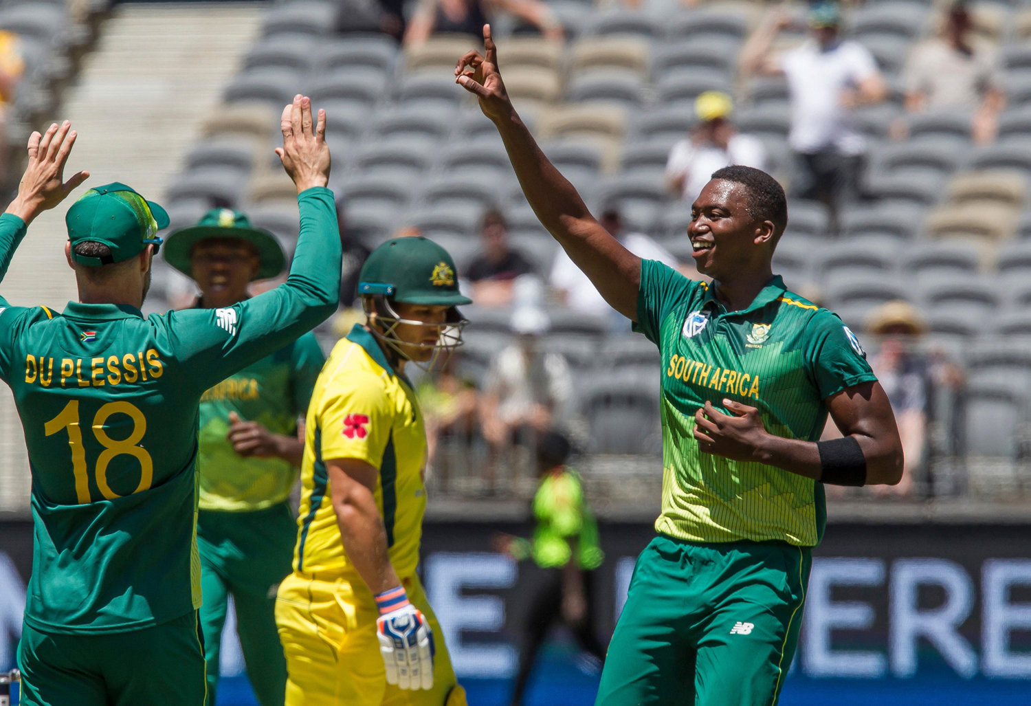 South Africa's Dale Steyn (2nd L-hatless) celebrates with teammates after taking a wicket during the first one-day international (ODI) cricket match between South Africa and Australia at the Optus Perth stadium in Perth on November 4, 2018. (Photo by TONY