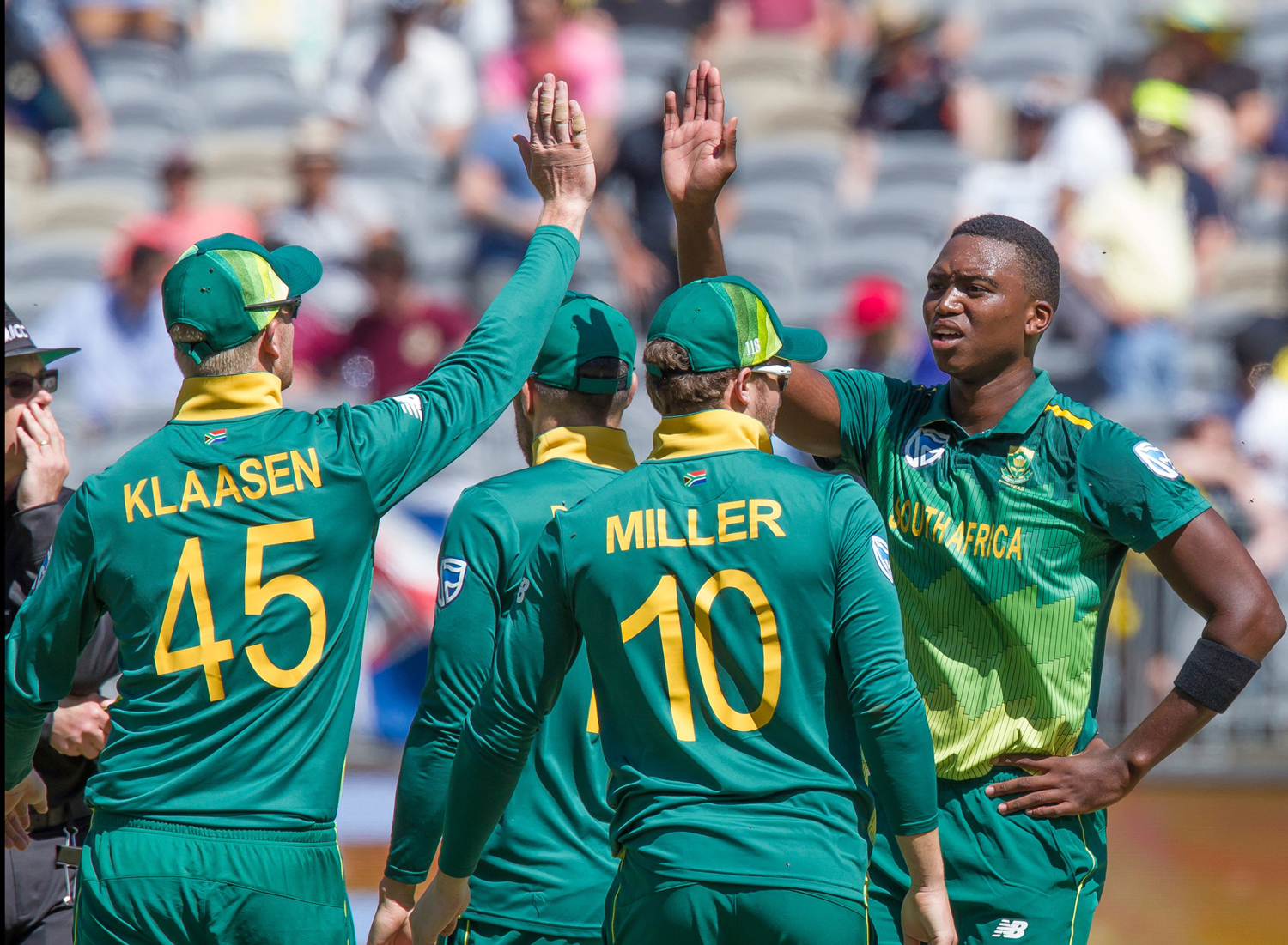 South Africa's Lungi Ngidi (R) celabrates with teammates after taking a wicket during the first one-day international (ODI) cricket match between South Africa and Australia at the Optus Stadium in Perth on November 4, 2018. (Photo by TONY ASHBY / AFP) / -
