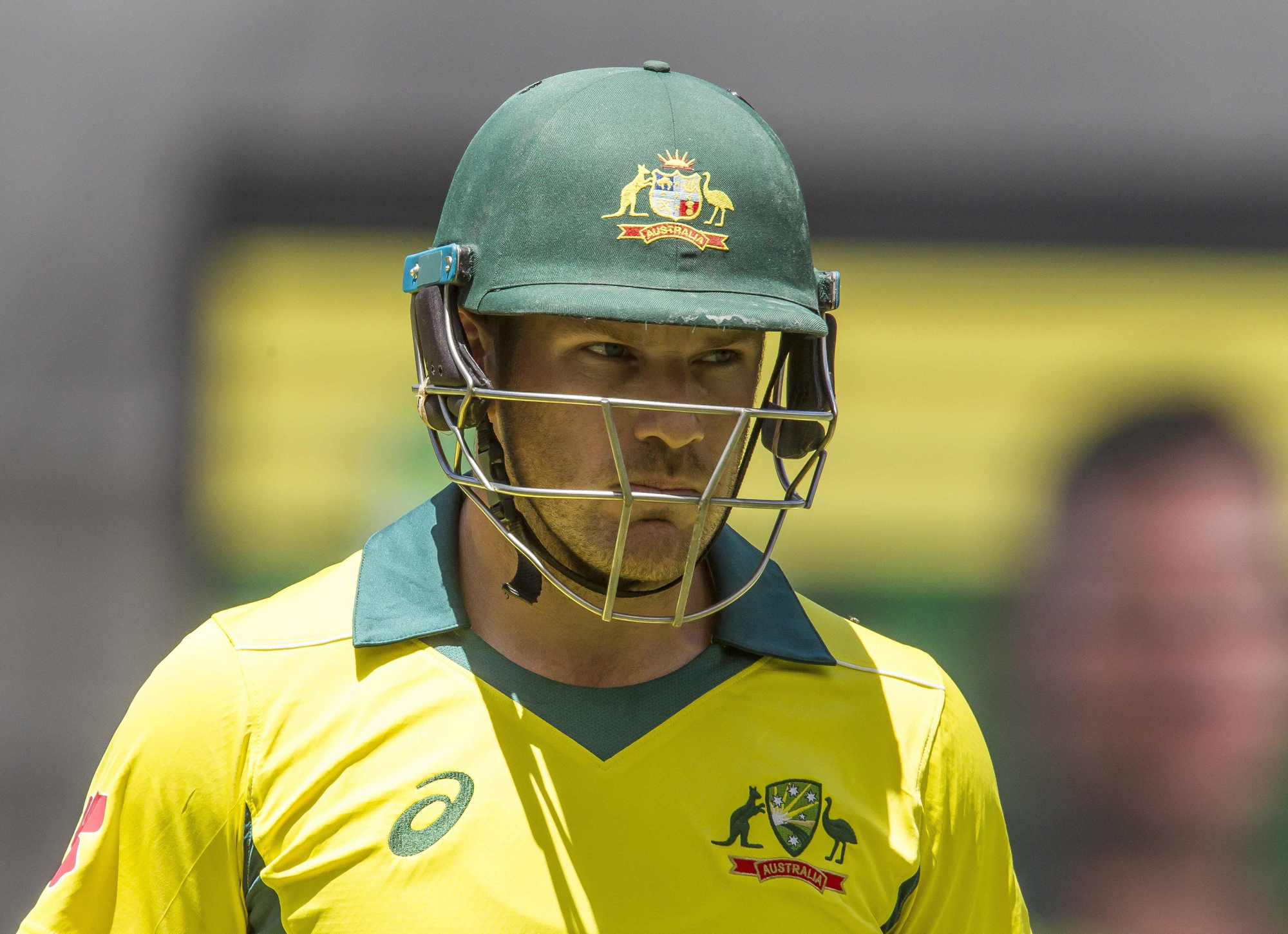 Australia's captain Aaron Finch walks off after being dismissed during the first one-day international (ODI) cricket match between South Africa and Australia at the Optus Stadium in Perth on November 4, 2018. (Photo by TONY ASHBY / AFP) / --IMAGE RESTRICT