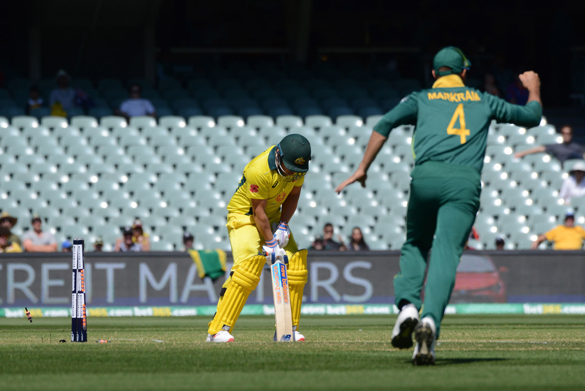 Australia's captain Aaron Finch (L) is out as South Africa's fieldsman Aiden Markram (R) celebrates during the second one day international cricket match between Australia and South Africa at the Adelaide Oval in Adelaide on November 9, 2018. (Photo by Br