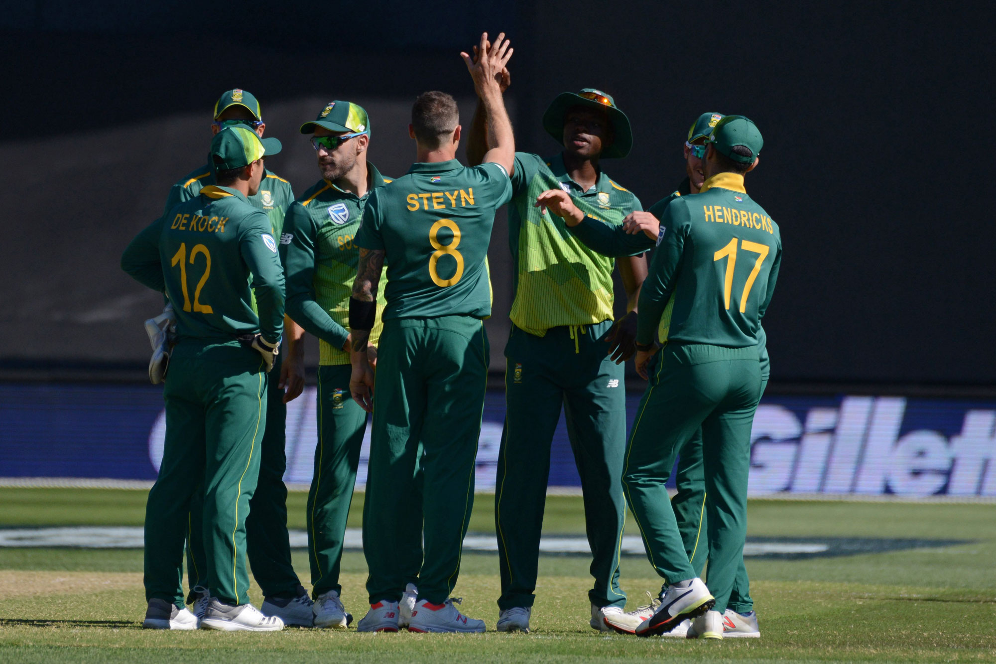 South African bowler Dale Steyn (C) celebrates with teammates after bowling out Australian batsman Pat Cummins during the second one day international cricket match between Australia and South Africa at the Adelaide Oval in Adelaide on November 9, 2018. (