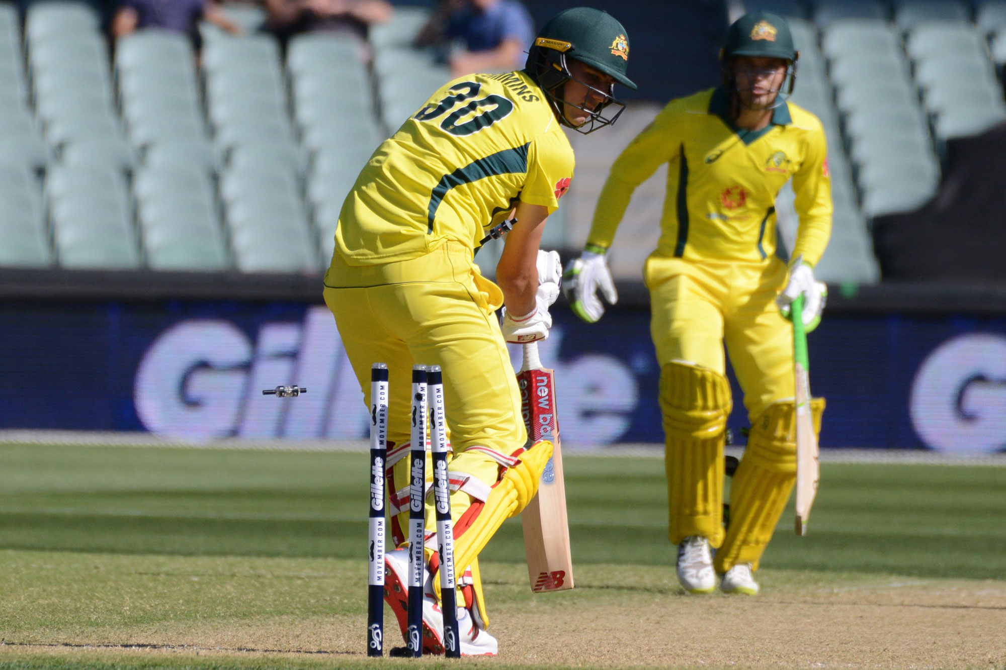 Australian batsman Pat Cummins (L) is bowled during the second one day international cricket match between Australia and South Africa at the Adelaide Oval in Adelaide on November 9, 2018. (Photo by Brenton EDWARDS / AFP) / -- IMAGE RESTRICTED TO EDITORIAL
