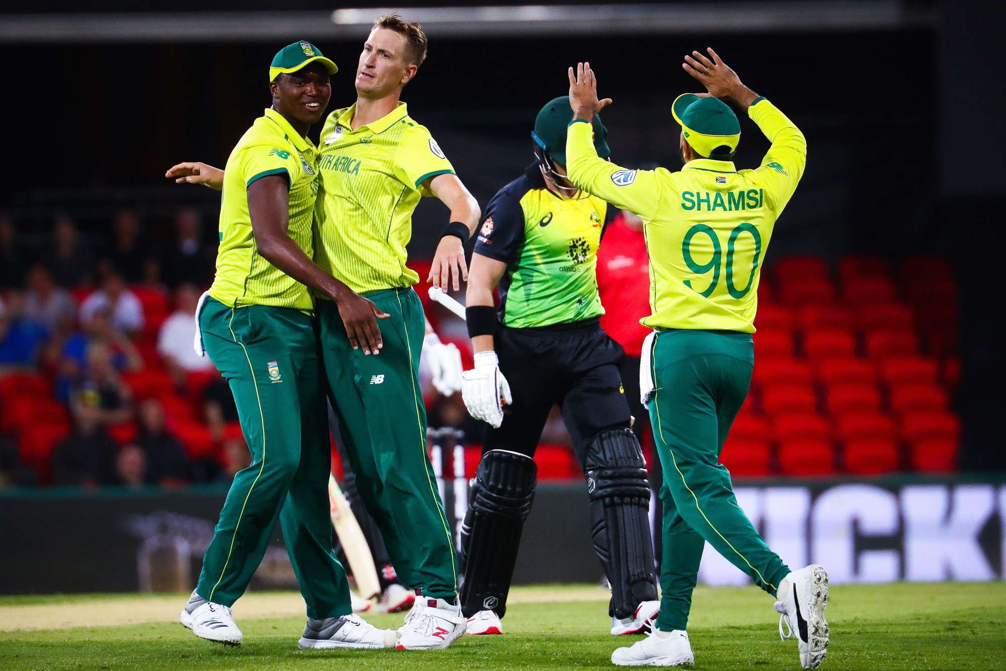 Chris Morris (C) of South Africa is congratulated by teammates after dismissing Australia's D'Arcy Short during the T20 international cricket match between Australia and South Africa at Metricon Stadium on the Gold Coast on November 17, 2018. (Photo by Pa
