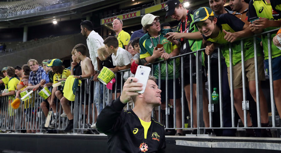 David Warner takes a selfie with fans