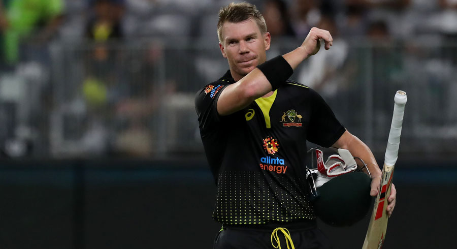 David Warner walks back to the pavilion