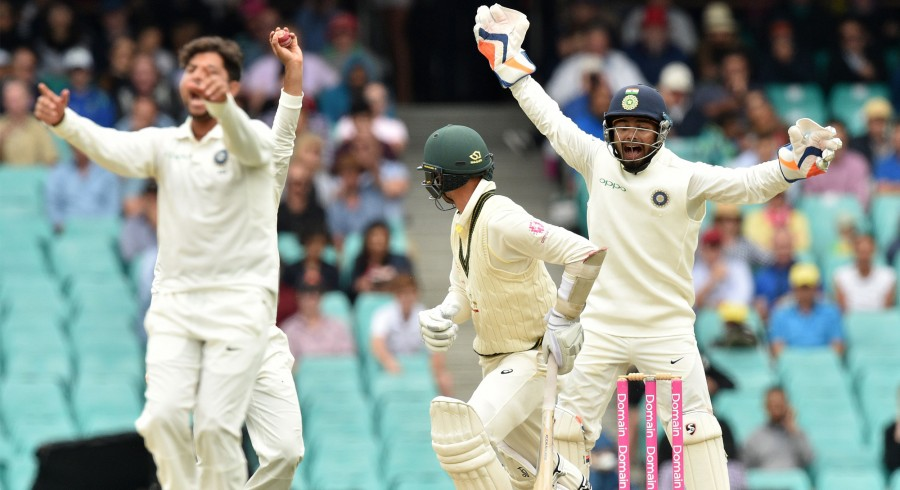 India force Australia follow-on before bad light ends play