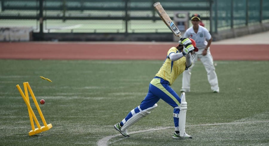 One grass pitch, 1.4 billion people - cricket on sticky wicket in China