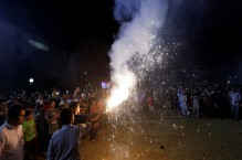 Pakistanis greet first World Cup win over India with fireworks and flags